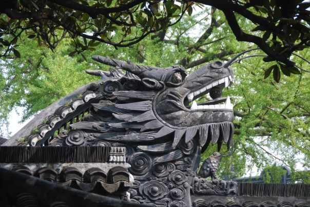 The 16th century Yu Yuan Garden - accented with huge stone dragons, rockeries. tea houses, ponds, and beautiful landscaping.  (photo by Robyn Bushong.)