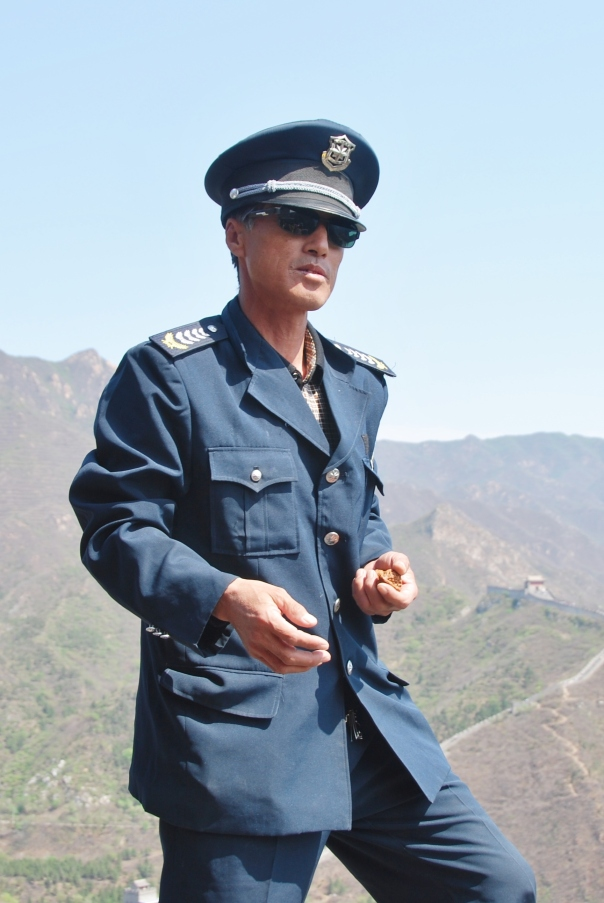 This guard is balancing on on a narrow ledge of The Great Wall as he watches the crowds.  (Photo by Robyn Bushong.)