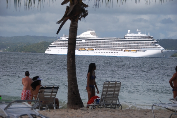 The stunning new 750-guest Seven Seas Explorer - anchored in the harbor of Cayo Levantado, Dominican Republic